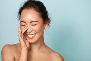 happy-woman-with-perfect-skin-dermatology-and-plastic-surgery